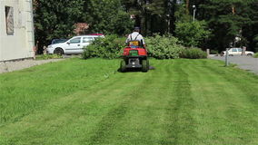 Gardener Mowing the Lawn stock video footage