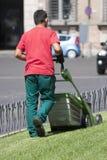 Gardener mowing worker (Piazza Venezia - Roma) Stock Images