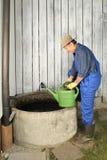 Gardener next to his Rain water barrel Stock Images