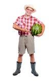 Gardener offers watermelon Royalty Free Stock Photo