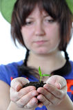 Gardener with plant in hands isolated Stock Photo