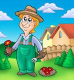 Gardener planting red flowers Stock Photo