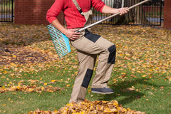 Gardener playing during his job Stock Image