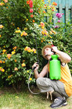Gardener with pump sprayer Royalty Free Stock Photo