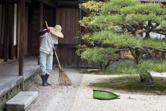 Gardener Raking Japanese Garden Royalty Free Stock Photo