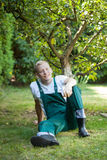 Gardener resting in orchard Royalty Free Stock Photo