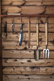 The Gardener's Potting Shed - Garden Tools. Rack of garden tools in a wooden shed ready for gardening royalty free stock photography
