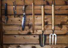 The Gardener's Potting Shed - Garden Tools. Rack of garden tools in a wooden shed ready for gardening stock photos