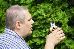 Gardener with shears Royalty Free Stock Photos