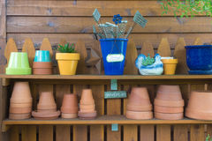 Gardener Shelf. A well-kept outdoor gardeners potting table, ready for you to work Royalty Free Stock Image