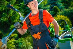Gardener with Shoulder Mower Royalty Free Stock Photography