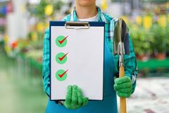 Gardener shows check list . Royalty Free Stock Photography