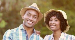 Gardener smiling couple holding basket stock footage