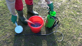 Gardener sprayer sprinkler in spring  and chemicals stock video footage