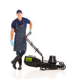 Gardener standing lawnmower Stock Photos