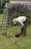 Gardener with tools to cut a hedge Royalty Free Stock Photo