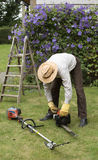 Gardener with tools to cut a hedge Stock Photography