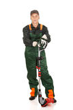 Gardener with trimmer and ear protectors Royalty Free Stock Photo