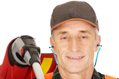 Gardener with trimmer and ear protectors Royalty Free Stock Images