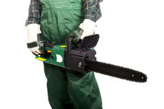 Gardener in uniform holding chainsaw Royalty Free Stock Photo