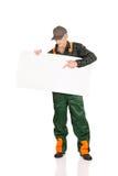 Gardener in uniform showing empty banner Stock Image