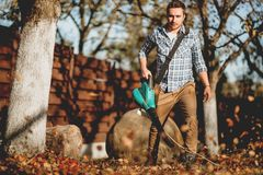 Free Gardener Using A Garden Blower, Clearing Up Leaves Stock Image - 129417601