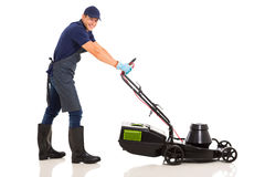 Gardener using lawnmower Royalty Free Stock Photo