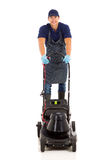 Gardener using lawnmower Royalty Free Stock Photography