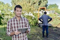 Gardener using tablet computer Stock Photography