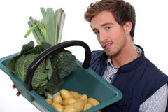 Gardener with vegetables Stock Photo