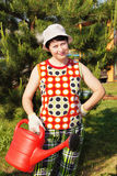 Gardener with a watering can Royalty Free Stock Image