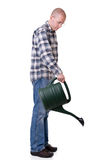 Gardener with a watering can Royalty Free Stock Photos