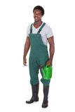 Gardener with watering can and pliers Royalty Free Stock Photos