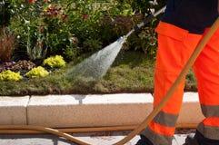 Gardener watering flowers Royalty Free Stock Photography