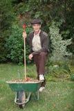Gardener with a wheelbarrow Stock Images