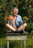 Gardener With Apples And Vegetables 1 Royalty Free Stock Images
