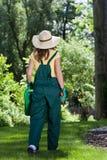 Gardener woman walking in garden Royalty Free Stock Images