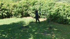 A gardener working in the caribbean stock video footage