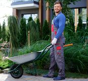 Gardener working in a garden Stock Image