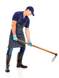 Gardener working hoe Stock Photo