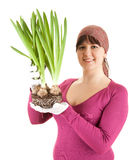 Gardener young woman with plant Royalty Free Stock Images