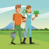 Gardeners couple plant pot water can landscape Stock Photos