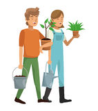 Gardeners couple plant pot water can Royalty Free Stock Image