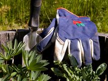 Gardeners Gloves and Hand Shovel. Old Dirty Gardeners Gloves and Hand Shovel royalty free stock images