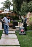 Gardeners Hard At Work. Gardeners work hard on a beautiful back yard in Irvine CA Stock Image