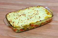 Gardeners Pie. Home made Gardeners Pie baked in a see through dish Stock Photos