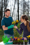 Gardeners planting flowers Stock Photo