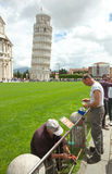 Gardeners staring sign r in Cathedral Squar, Pisa. Royalty Free Stock Image