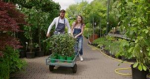Gardeners with wagon stock footage