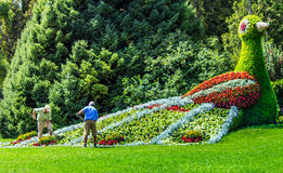 Gardeners working at the flower bird on Flower Island Mainau, a unique Island of Flower, Lake Constance, Germany Stock Images